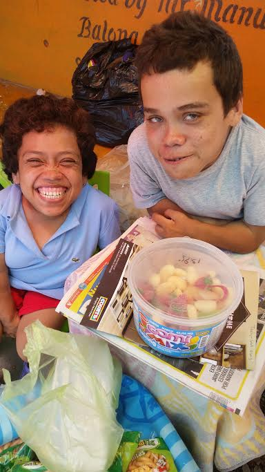 My friends from my former Belizean home in Succotz Village, shown here at the market booth where they sell chips, candies, gums and trinkets every Saturday.