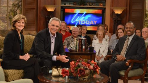 "Happy Ben Carson with the ""deeply troubled"" TV evangelist James Robison (left, with wife Betty)."