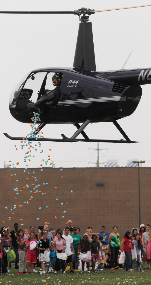 A helicopter, hired by Community Life Church, makes the third of four drops at one-of-a-kind Easter event in McKinney Saturday April 23,2011. The 30,000 eggs were dropped four times, by Epic Helicopters of Fort Worth, for the children who gathered the eggs in four different age groups. (Ron Baselice/The Dallas morning News) 04242011xMETRO