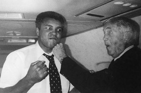 "One thing we loved about Ali was his ability to charm the snakes out of the trees: the guy could be a hilarious ham.  United Methodist Bishop James K. Mathews is picture here throwing a left to Ali.  United Methodist theologian Ted Campbell explained on his Facebook page: ""They were apparently sitting together on a flight, began talking, Bishop Mathews asked for a photo, and Ali said, ""Sure. Throw me a punch!"" (From the back cover of Mathews's autobiography, A Global Odyssey.)"