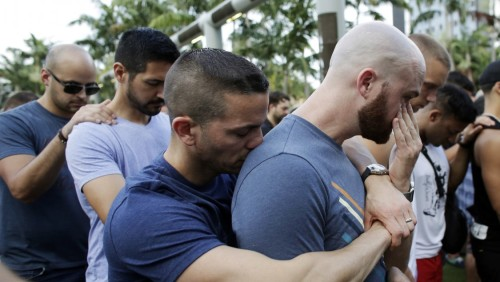 Mourners at a vigil in Orlando. People who were being demonized a few days are now being hailed as good, innocent Americans by flip-flopping leaders who never miss an opportunity to exploit a horrible event.(AP photo by Lynne Skadky.)