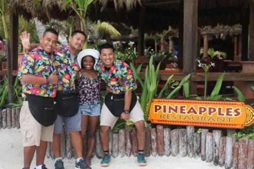 Olympian star Simone Biles, who was adopted and raised by a family  in Spring, Texas , outside Houston, has Belizean roots. Shown here hamming it up with boys on Belize's famous San Pedro resort town.